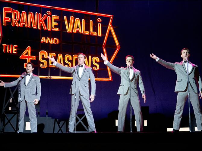 Film Review-Jersey Boys John Lloyd Young as Frankie Valli, Erich Bergen as Bob Gaudio, Vincent Piazza as Tommy DeVito, and Michael Lomenda as Nick Massi in '‍Jersey Boys.'
