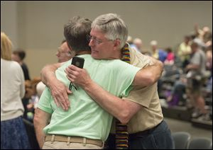 Gary Lyon, of Leechburg, Pa., left, and Bill Samford, of Hawley, Pa.., celebrate after a vote allowing Presbyterian pastors discretion in marrying same-sex couples at the 221st General Assembly of the Presbyterian Church.
