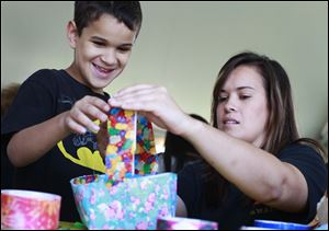 Isaac Dandra, 8, left, makes a Duck Tape basket with his sister Hannah Dandra, right, both from Lorain, Ohio, at a workshop during the 11th annual Duck Tape Festival on June 14 at Veterans Memorial Park in Avon, Ohio.