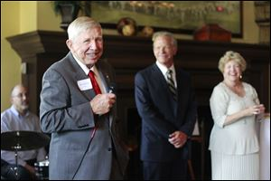 Dick Anderson, left,  says a few words during the reception for the Toledo Symphony held at the Inverness Club in Toledo.