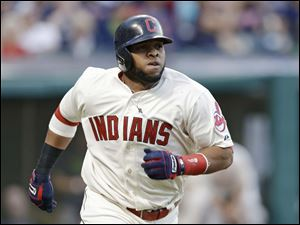 Cleveland Indians' Carlos Santana watches his solo home run off Detroit Tigers starting pitcher Justin Verlander.
