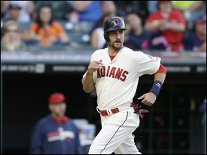Cleveland Indians' Lonnie Chisenhall scores on a hit by Nick Swisher in the second inning.