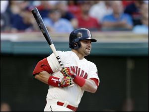 Cleveland Indians' Nick Swisher follows through on a ball hit to Detroit Tigers second baseman Ian Kinsler.