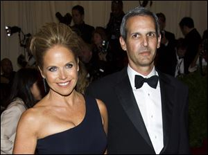"Katie Couric, left, and John Molner attend The Metropolitan Museum of Art's Costume Institute benefit celebrating ""PUNK: Chaos to Couture"" in New York."