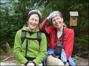 Missing hiker Karen Sykes, right, with her friend Lola Kemp. Crews are searching Mount Rainier National Park for Sykes, a prominent hiker and outdoors writer who was reported missing late Wednesday.