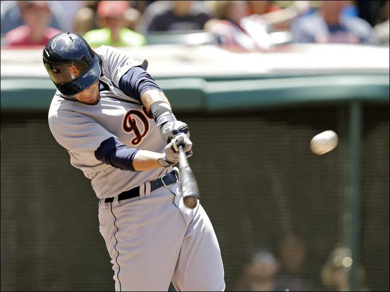 Detroit Tigers' Nick Castellanos doubles to drive in two runs off Cleveland Indians starting pitcher Josh Tomlin.