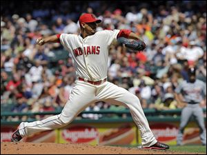 Cleveland Indians relief pitcher Carlos Carrasco delivers against the Detroit Tigers.