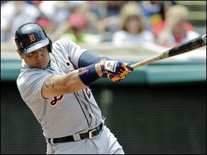 Detroit Tigers' Miguel Cabrera singles to drive in a run.