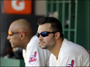 Cleveland Indians' Nick Swisher watches from the dugout.
