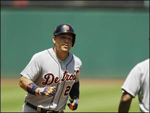 Detroit Tigers' Miguel Cabrera rounds the bases after a solo home run off Cleveland Indians starting pitcher Josh Tomlin.
