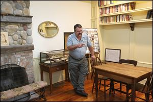 J.D. Justus, Perrysburg Area Historical Museum board member, discusses features of one of the restored rooms in the Spafford House Museum at 27340 River Road just west of Fort Meigs.