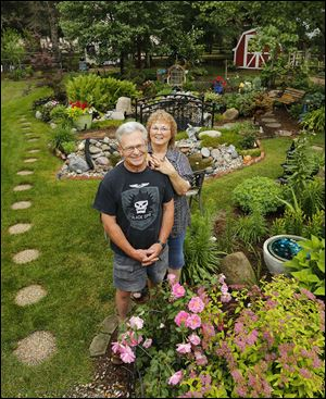 Ken and Jeanie Lutz will display their garden at their Lambertville home during the Bedford Garden Club tour on July 18.