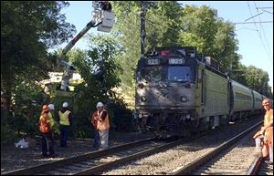 An Amtrak train struck a vehicle overnight in Mansfield, Mass. Three people in the vehicle were killed. Service on Amtrak and MBTA lines was delayed while the crash was investigated.