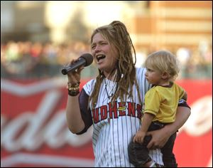 American Idol contestant Crystal Bowersox sang the national anthem with her son, Tony, in 2010.