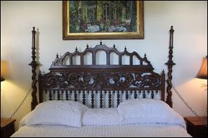 The headboard over the master bed (two twins pushed together) in author Ernest Hemingway's former Key West, Fla., home is actually a gate from a Spanish monastery.