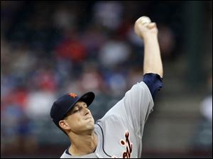 Detroit Tigers' Drew Smyly delivers to the Texas Rangers.
