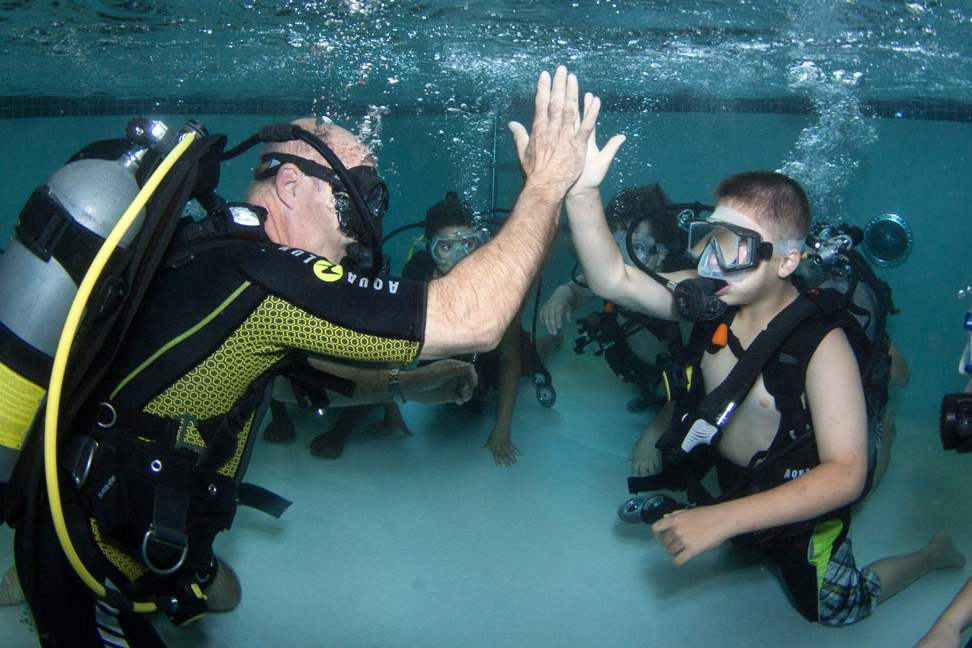 CTY-scuba26pAqua-Hut-owner-Jeff-Davis-left-high-fives-Alexan
