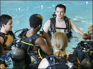 Aqua Hut instructor candidate Zech Hites instructs students on Wednesday at the Maritime Academy's pool at 803 Water St.