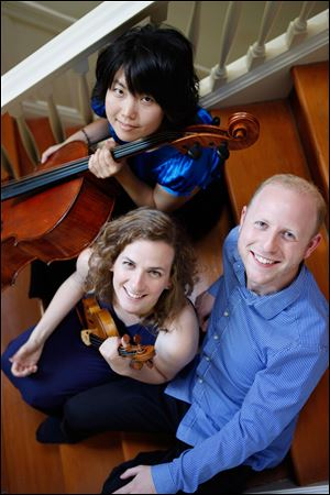 The Delphi Trio — Michelle Kwon, top, Liana Berube, and Jeffrey LaDeur — will perform at 8 p.m. Friday at Kerrytown Concert House in Ann Arbor.