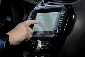 A demonstration of Android Auto is given during the Google I/O 2014 keynote presentation in San Francisco, Wednesday.