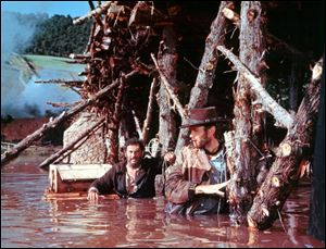 Eli Wallach, left, and Clint Eastwood, right, in a scene from 'The Good, the Bad and the Ugly.'
