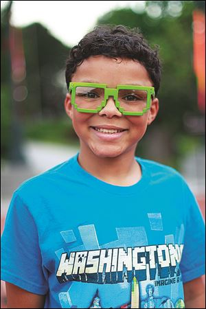 Zachriah Burch, 11, sports his Space Invaders inspired exhibit glasses.