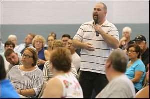 Rob Barron asks about a blighted property in his neighborhood on Church Street during a town hall meeting with the mayor on Wednesday.