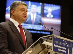 Ukrainian President Petro Poroshenko delivers his speech at the Parliamentary Assembly of theCouncil of Europe in Strasbourg, eastern France, today.