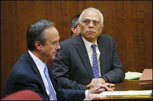 Dr. Nabil Ebraheim, 63, right, sits with his attorney Jerry Phillips during his bench trial before Judge Timothy Kuhlman in Toledo Municipal Court. Dr. Ebraheim was found guilty of vehicular manslaughter, a misdemeanor, for causing the death of motorcyclist Lawrence J. Hilton, 54, of Swanton in August.