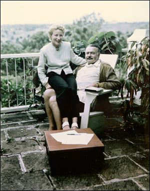 In this 1948 photo, writer Ernest Hemingway sits with his fourth wife, Mary, in Cuba.
