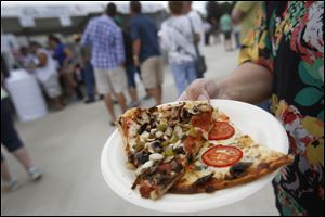 Slices of pizza fill a plate at last year's Pizza Palooza at Centennial Terrace in Sylvania. This year's event will be July 25-26.