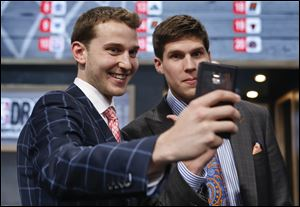 Michigan's Nik Stauskas, left, and Creighton's Doug McDermott pose together for a selfie before the start of the 2014 NBA Draft tonight in New York.