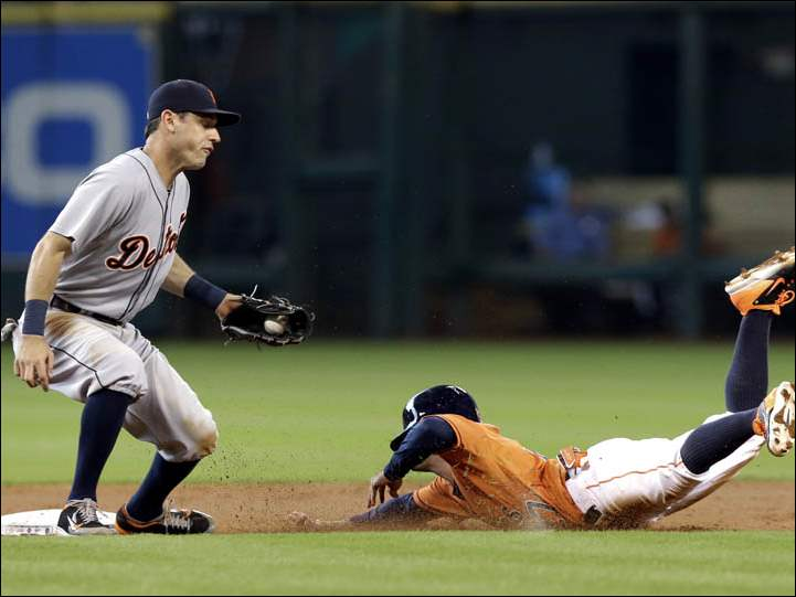 Houston Astros' Jose Altuve, right, steals second base as Detroit Tigers second baseman Ian Kinsler, left, turns to try for the tag.
