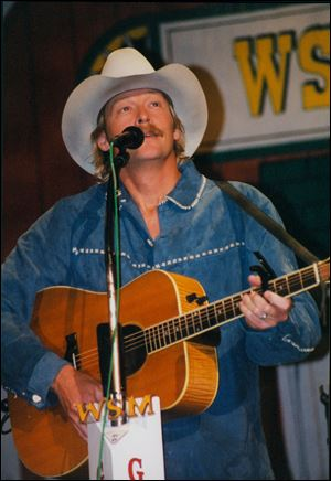 In this undated photo provided by Paul Eckhart, Alan Jackson performs at the Opry House, in Nashville, Tenn.