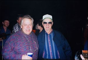 In this undated photo provided by Lindy McKim, country music singer John Conlee, left, poses with fan Paul Eckhart at the Opry House, in Nashville, Tenn.