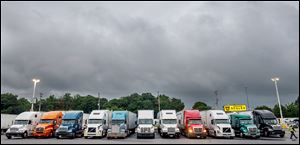 Tractor-trailers park at a stop along I-95 near Jessup, Md.
