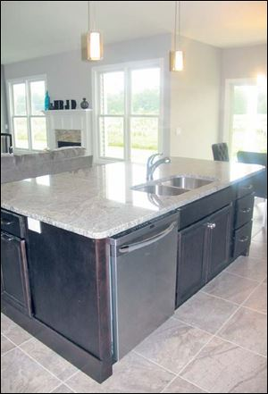 The kitchen island is extra wide, and every meal here will be created and enjoyed in comfort.