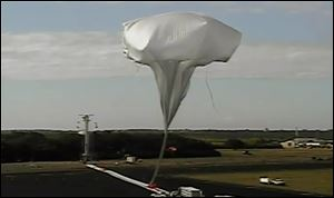 This image provided by NASA shows the launch of the high-altitude balloon carrying a saucer-shaped vehicle for NASA, to test technology that could be used to land on Mars, Saturday June 28, 2014 in Kauai, Hawaii. Saturday's experimental flight high in Earth's atmosphere is testing a giant parachute designed to deliver heavier spacecraft and eventually astronauts.