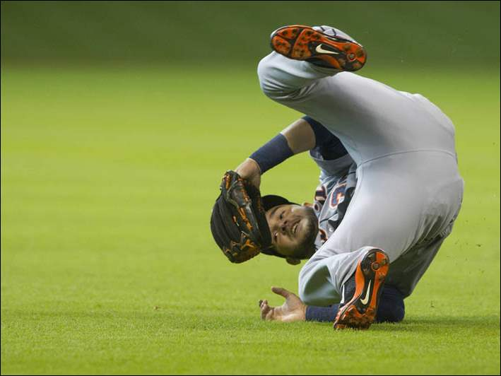 Detroit Tigers shortstop Eugenio Suarez flips after trying to make a diving catch.