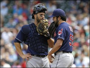 Cleveland Indians starting pitcher T.J. House, right, talks with catcher George Kottaras.