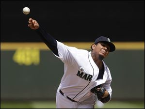 Seattle Mariners starting pitcher Felix Hernandez throws against the Cleveland Indians.