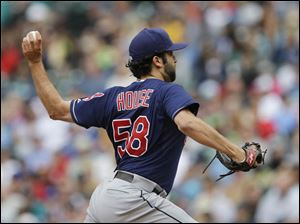 Cleveland Indians starting pitcher T.J. House throws against the Seattle Mariners.