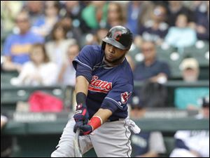Cleveland Indians designated hitter Carlos Santana breaks his bat as he grounds out.