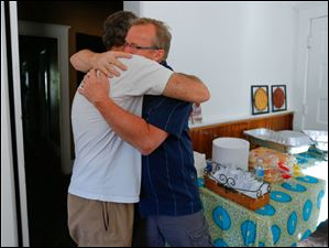Mitch Magditch, left, hugs pastor Steve North.