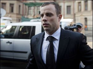 Oscar Pistroius arrives at court in Pretoria, South Africa, today. The murder trial resumed after one month during which mental health experts evaluated the athlete to determine if he has an anxiety disorder that could have influenced his actions on the night he killed his girlfriend Reeva Steenkamp.