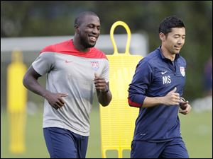 United States' Jozy Altidore, left, works out with trainer Masa Sakihana. Altidore is expected to return from a hamstring injury today.