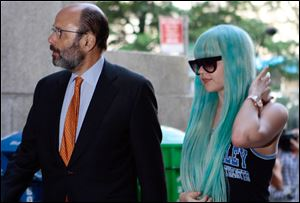 Amanda Bynes, accompanied by attorney Gerald Shargel, arrives for a court appearance in New York in July, 2013 on allegations that she chucked a marijuana bong out the window of her 36th-floor Manhattan apartment.