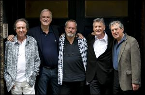 From left, Eric Idle, John Cleese, Terry Gilliam, Michael Palin and Terry Jones of the comedy group Monty Python during a press conference today in London.