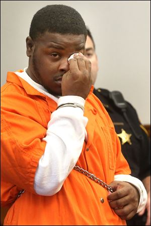Tyrone Hoskins, Jr., wipes a tear from his eye while entering his guilty plea Monday to reckless homicide with a firearms specification in the Feb. 2 shooting death of Michael Williams during a chaotic scene outside an after-hours club.