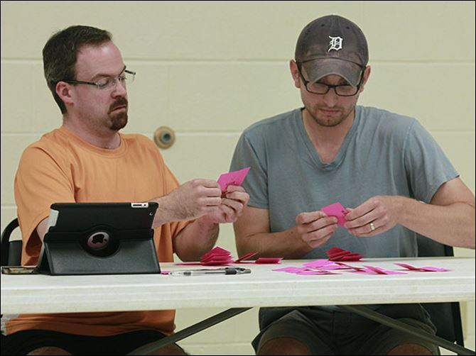CTY repubs02pExecutive committee memb Executive committee members Troy Dowling, left, and Ryan Schueler count ballots during the meeting at the Maumee Senior Center to nominate Judge Peter Handwork and Patrick Kriner.